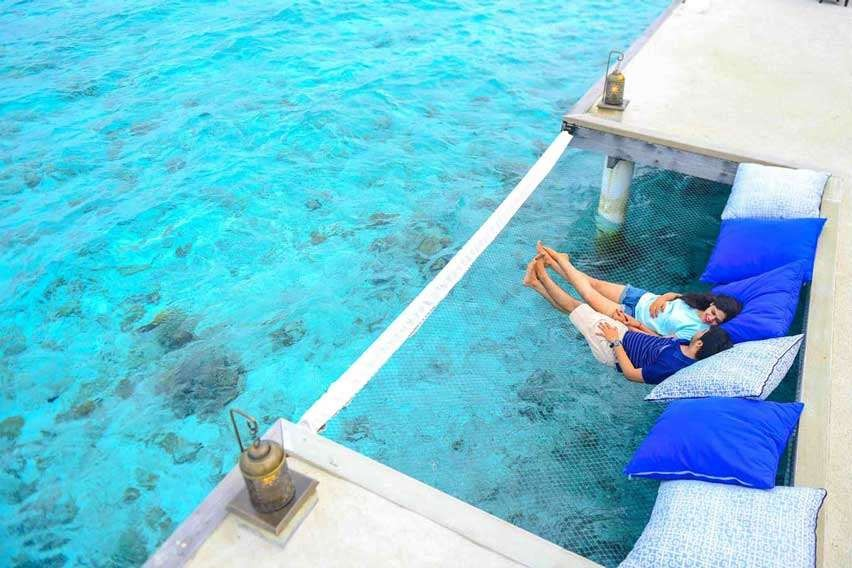 Couple Relaxing at Maldives Resort, Via:Asad.photo
