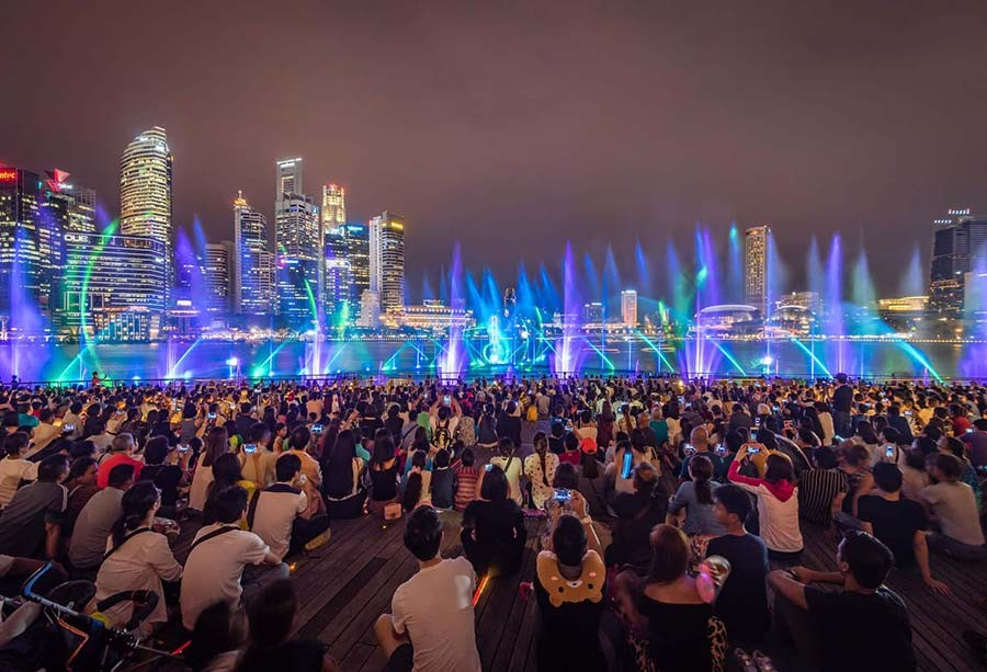 People enjoying the light show at Marina Bay Sands, Via: lonelyplanet.com