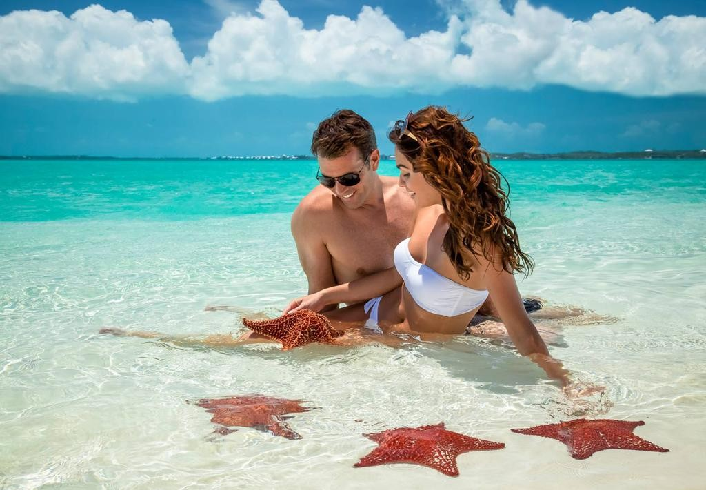 Couples at beach in Freeport Bahamas